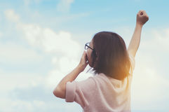 Relaxation, Hapiness, Early morning  concept. Woman yawning with arms stretched on blue sky background Stock Photography