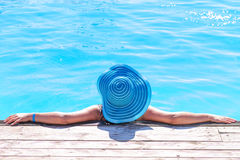 Relaxation on holidays at the pool Royalty Free Stock Image