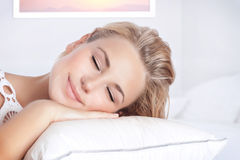 Relaxation at home. Closeup portrait of nice female sleeping in bedroom at home, calm peaceful bed time, healthy lifestyle, conception of relaxation Stock Images