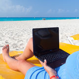 Relaxation with laptop on holiday Royalty Free Stock Photography