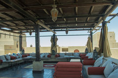 Relaxation lounge in the restaurant on the roof with comfortable sofas. And pillows Stock Photos