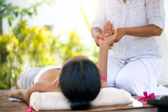 Relaxation massage outdoor. Woman receiving relaxation hand massage Royalty Free Stock Photos