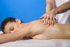 Relaxation. Masseur doing massage on woman body in the spa salon Royalty Free Stock Images