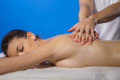 Relaxation. Masseur doing massage on woman body in the spa salon Royalty Free Stock Photography