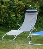 Relaxation place - garden with deck chair Stock Image