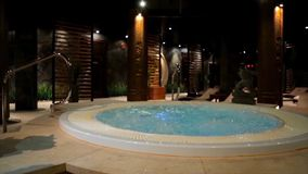 Jacuzzi Sauna Piscina.Relaxation Pool In Spa With Waterfall Empty Luxury Spa With