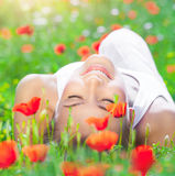 Relaxation on poppy flower field Stock Photos