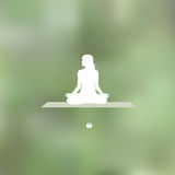 Relaxation pose Blurred green background Stock Photo