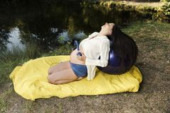 Relaxation Pregnant Music Park Lake Calmness. Selective focus Royalty Free Stock Photography