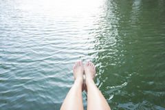 Relaxation by putting legs into water. Concept of relaxation by putting legs into water Royalty Free Stock Photo