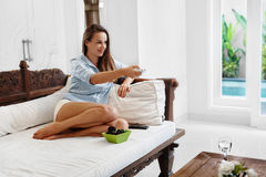 Relaxation. Recreation. Woman Relaxing, Watching TV. Television Royalty Free Stock Image