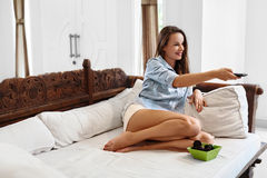 Relaxation. Recreation. Woman Relaxing, Watching TV. Television Stock Photography