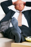 Relaxation - Relaxed business man lying on a sofa Royalty Free Stock Photos