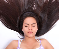 Relaxation and rest. Woman with closed eyes and long hair in an attitude of relaxation and rest Stock Photography