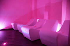 Relaxation  room on dark red illumination. Stock Images