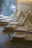 Relaxation room with deckchairs in row Stock Photography
