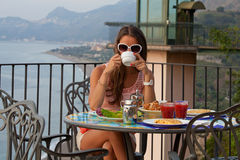 Relaxation with a seaview and cup of coffee Royalty Free Stock Photography