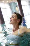 Relaxation in the seawater pool. Woman relaxing in seawater spa pool royalty free stock photos