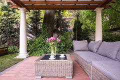 Relaxation space in garden. Picture of relaxation space in garden with elegant rattan furniture Stock Images