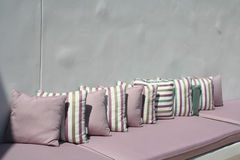 Relaxation Spot. Outdoor patio couch with purple cushions Stock Image