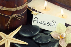 Relaxation. Stones for spa massage by candlelight Stock Photo