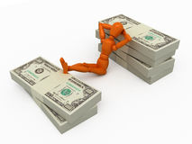 Relaxation after success. Orange mannequin with stackes of money Royalty Free Stock Photo