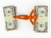 Relaxation after success. Orange mannequin with stackes of money Royalty Free Stock Photos