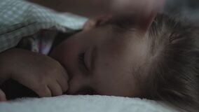 Relaxation, Sweet Dreams, Childhood, Family Concepts - Tight close up preschool toddler kid girl Sleep on Bed in Dark