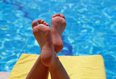 Relaxation at swimming pool Royalty Free Stock Photography