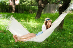 Relaxation time. Young woman lying down on hammock Royalty Free Stock Image
