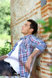 Relaxation time in garden. Man relaxing on bench during week-end in countryside Stock Photos