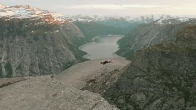 Relaxation on the Trolltunga in the Norway.  stock footage