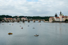 Relaxation Vltava river cruises before the Charles Bridge in Prague Royalty Free Stock Photo