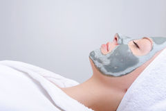 Relaxation - woman with mask of clay Royalty Free Stock Photography