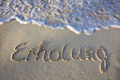 Relaxation written in sand . Royalty Free Stock Photos