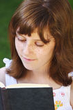 Relaxation.Young beautiful girl reading a book outdoor Royalty Free Stock Photo