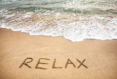 Relaxe a palavra na areia Foto de Stock Royalty Free