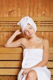 Relaxed женщина в sauna Стоковое Изображение RF
