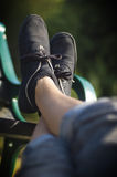 Relaxed. A nice, clean image of a pair of feet resting on a park bench in the sun. Extremely shallow depth of field, could easily be used in any design, enjoy Stock Photos