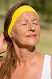 Relaxed active mature woman portrait Stock Image