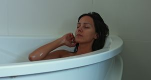 Relaxed woman sleeping in bath. stock footage