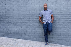 Relaxed african american man leaning against wall Royalty Free Stock Photo