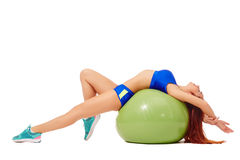 Relaxed athlete resting lying on fitness ball Stock Photos