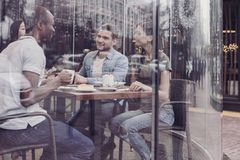 Double exposure of delighted friends that being in cafe royalty free stock images