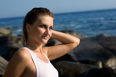 Relaxed attractive girl after a swim in the sea. Royalty Free Stock Photos