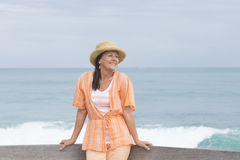 Relaxed attractive mature woman beach Royalty Free Stock Image