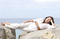 Relaxed attractive mature woman lying at ocean Stock Image