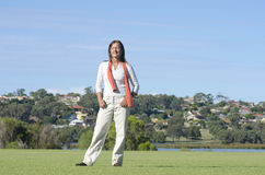 Relaxed attractive mature woman outdoor park Stock Photo