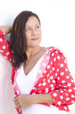 Relaxed attractive mature woman white background Royalty Free Stock Images