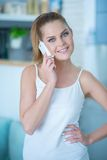 Relaxed attractive woman using a mobile phone Royalty Free Stock Photo